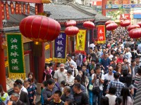 People crowd famous Wangfujing snack street during National Day holiday on October 4, 2013 in Beijing, China - iStockPhoto / Getty Images